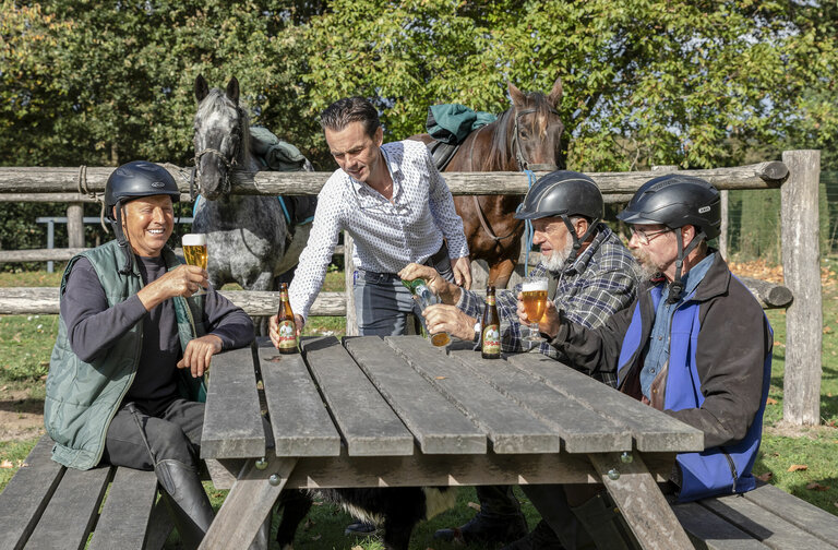 Enjoying a beer in a horse-friendly café